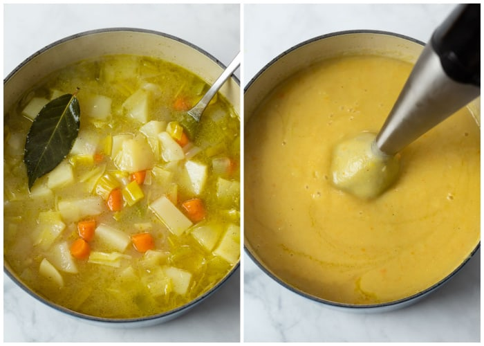 An immersion blender blending vegetables, potatoes, and broth for Potato Leek Soup.