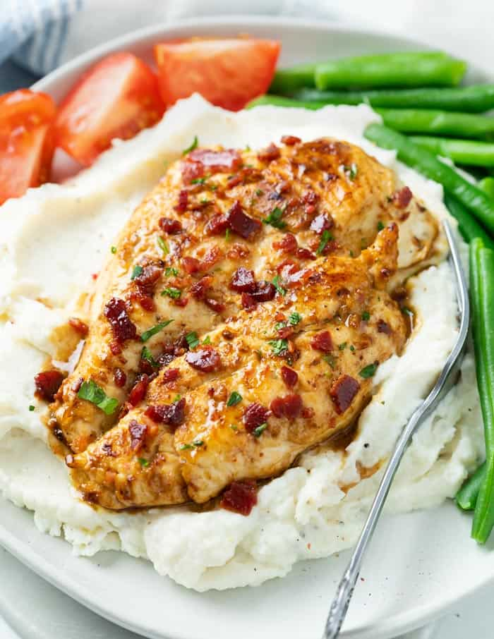 This easy chicken marinade is perfect for chicken that's baked, grilled, or fried in a skillet! Use this recipe for chicken breast, thighs, drumbsticks, or wings!