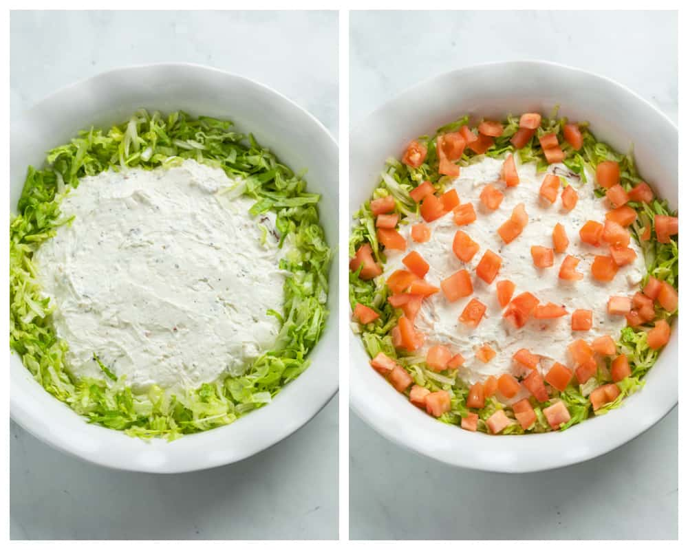 A white pie pan with BLT dip with shredded lettuce and diced tomatoes being added on top.