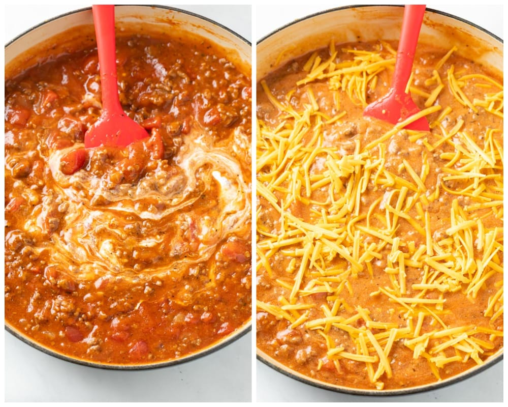 A pot filled with creamy tomato sauce with cheese being added for ground beef casserole.