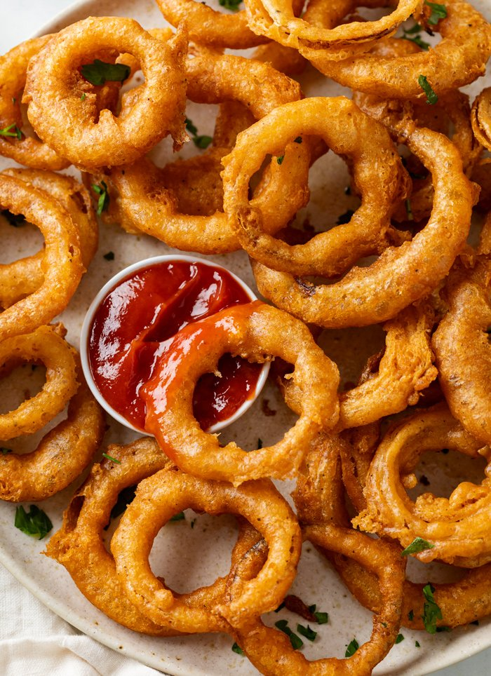 These homemade onion rings are deep fried in a flavorful batter and are so easy to make from scratch! Serve them with dipping sauce for fun appetizer idea.