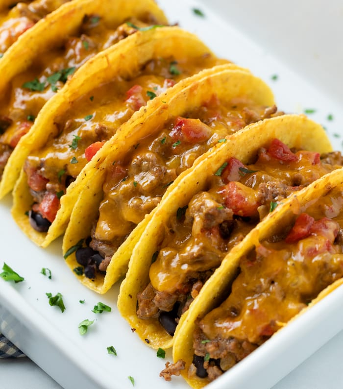 Baked Tacos with beef and cheese in a casserole dish.