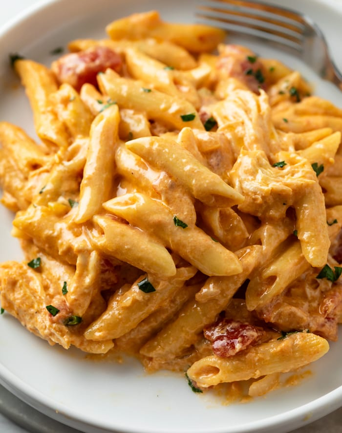 A white plate topped with creamy Buffalo Chicken Pasta.