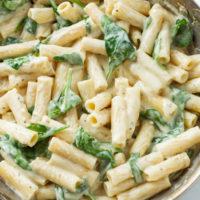 Creamy Spinach Pasta in a silver skillet.