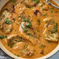 Tuscan Chicken in a creamy sauce with spinach and sun dried tomatoes.