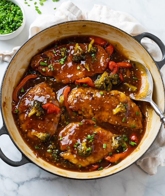 A skillet filled with Honey Garlic Chicken with Glaze, Broccoli, and Peppers.